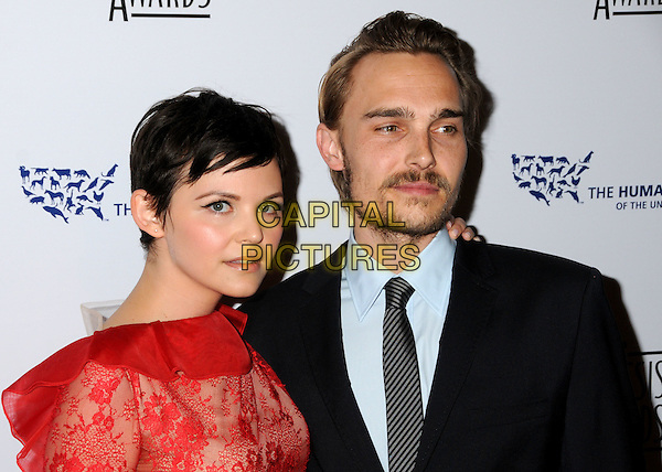 GINNIFER GOODWIN & JOEY KERN .24th Annual Genesis Awards - Arrivals held at the Beverly Hilton Hotel, Beverly Hills, California, USA, 20th March 2010..portrait headshot couple red lace blue shirt grey gray black striped tie beard goatee facial hair ruffle neck .CAP/ADM/BP.©Byron Purvis/AdMedia/Capital Pictures.
