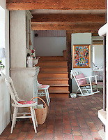 The farmhouse retains its original early 18th century wooden beams