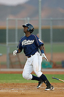 Franmil Reyes #26 of the AZL Padres bats against the AZL Reds at the Cincinnati Reds Spring Training Complex on July 13, 2013 in Goodyear, Arizona. AZL Reds defeated the AZL Padres, 11-10. (Larry Goren/Four Seam Images)