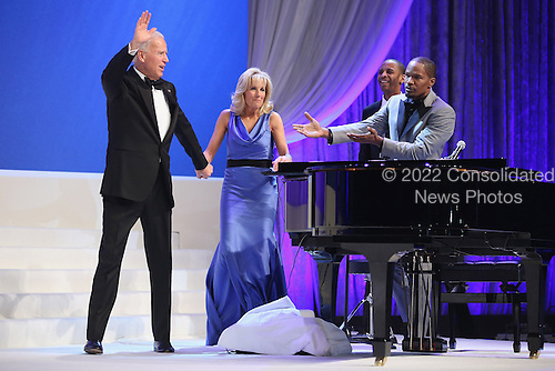 United States Vice President Joe Biden (L) and Dr. Jill Biden wave goodbye after actor and musician Jamie Foxx (R) sang while they danced at the Inaugural Ball at the Walter Washington Convention Center January 21, 2013 in Washington, DC. Biden and President Barack Obama started their second term by taking the Oath of Office earlier in the day during a ceremony on the West Front of the U.S. Capitol.  .Credit: Chip Somodevilla / Pool via CNP