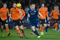27th December 2019; Dens Park, Dundee, Scotland; Scottish Championship Football, Dundee Football Club versus Dundee United; Danny Johnson of Dundee in a race for the ball with Mark Reynolds of Dundee United  - Editorial Use