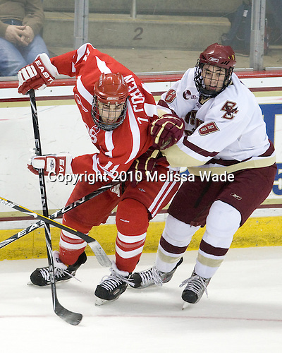 Zach Cohen (BU - 11), Edwin Shea (BC - 8) - The Boston University Terriers defeated the Boston College Eagles 5-4 (OT) on Friday, January 22, 2010, at Conte Forum in Chestnut Hill, Massachusetts.