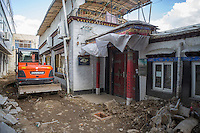 A bulldozer digs up the road for repair outside the School for the Blind in Tibet, in the capital city of Lhasa, September 2016.