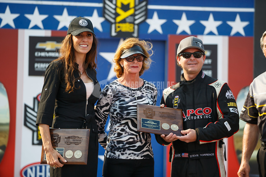 Sep 4, 2017; Clermont, IN, USA; NHRA top fuel driver Steve Torrence (right) with mother Kay Torrence (center) and Taya Kyle during the US Nationals at Lucas Oil Raceway. Mandatory Credit: Mark J. Rebilas-USA TODAY Sports