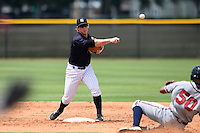 GCL Yankees 1 second baseman Ryan Lindemuth (2) attempts to turn a double play as Alejandro Flores (50) slides in during the second game of a doubleheader against the GCL Braves on July 1, 2014 at the Yankees Minor League Complex in Tampa, Florida.  GCL Braves defeated the GCL Yankees 1 by a score of 3-1.  (Mike Janes/Four Seam Images)