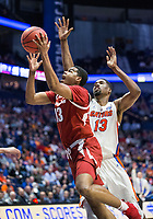 NWA Democrat-Gazette/BEN GOFF @NWABENGOFF<br /> Mason Jones, Arkansas guard, shoots as Kevarrius Hayes,  Florida center, defends in the second half Thursday, March 14, 2019, during the second round game in the SEC Tournament at Bridgestone Arena in Nashville.