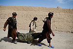 Afghans retrieve neighbors shot by British troops in Sangin, Helmand province on Sunday, April 8, 2007.