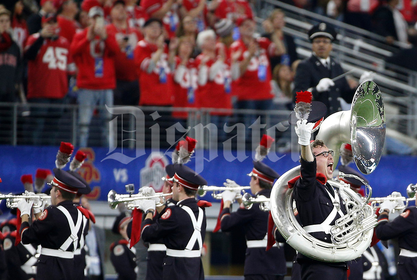 "Ohio State euphonium player Andrew Hartstein, of Beachwood, Ohio, lets out a yell as he dots the ""i"" during ""Script Ohio"" before the Goodyear Cotton Bowl Classic between the Ohio State Buckeyes and the USC Trojans on Friday, December 29, 2017 at AT&T Stadium in Arlington, Texas. [Joshua A. Bickel/Dispatch]"