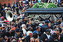 Musicians follow hearse during funeral for slain rapper Magnolia Shorty, 2010