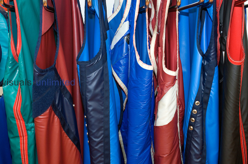 A selection of multi-coloured lead-lined jackets to protect doctors and technicians against radiation while using radiology equipment. Royalty Free