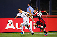 Angel Di Maria (22) of Real Madrid is marked by Luca Antonini (77) of A. C. Milan. Real Madrid defeated A. C. Milan 5-1 during a 2012 Herbalife World Football Challenge match at Yankee Stadium in New York, NY, on August 8, 2012.