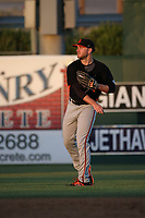 Heath Quinn (38) of the San Jose Giants throws in the outfield between innings of a game against the Lancaster JetHawks at The Hanger on May 5, 2017 in Lancaster, California. San Jose defeated Lancaster, 4-2. (Larry Goren/Four Seam Images)
