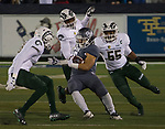 Nevada running back Toa Taua is surrounded by the Colorado State defense in the first half of an NCAA college football game in Reno, Nev., Saturday, Oct. 27, 2018. (AP Photo/Tom R. Smedes)