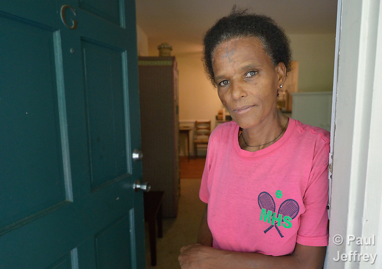 Ethiopia Beru, a refugee from Eritrea, poses in the front door of her apartment in Durham, North Carolina. <br /> <br /> Beru was resettled in Durham by Church World Service, which resettles refugees in North Carolina and throughout the United States.<br /> <br /> <br /> Photo by Paul Jeffrey for Church World Service.