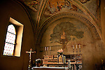 A small church in the Italian town of Carimate, near Como, with an unusual fresco of a Madonna and Child in a tree