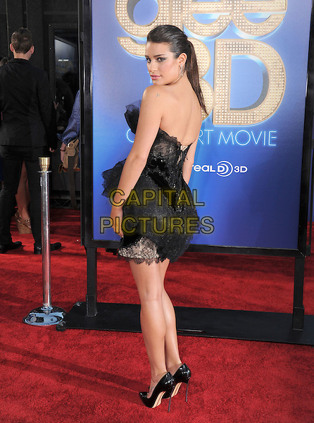 Lea Michele.attends The 20th Century Fox 'Glee 3D' Concert World Movie Premiere held at The Regency Village theatre in Westwood, California, USA, .August 6th 2011..full length ponytail  dress strapless black hair up tulle  lace tiered ruffles  pointy shoes heels walking mini back over shoulder rear behind looking .CAP/RKE/DVS.©DVS/RockinExposures/Capital Pictures.