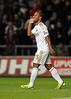 Sunday, 28 November 2012<br /> Pictured: Wayne Routledge of Swansea celebrating his goal immitating fellow player's Michu.<br /> Re: Barclays Premier League, Swansea City FC v West Bromwich Albion at the Liberty Stadium, south Wales.