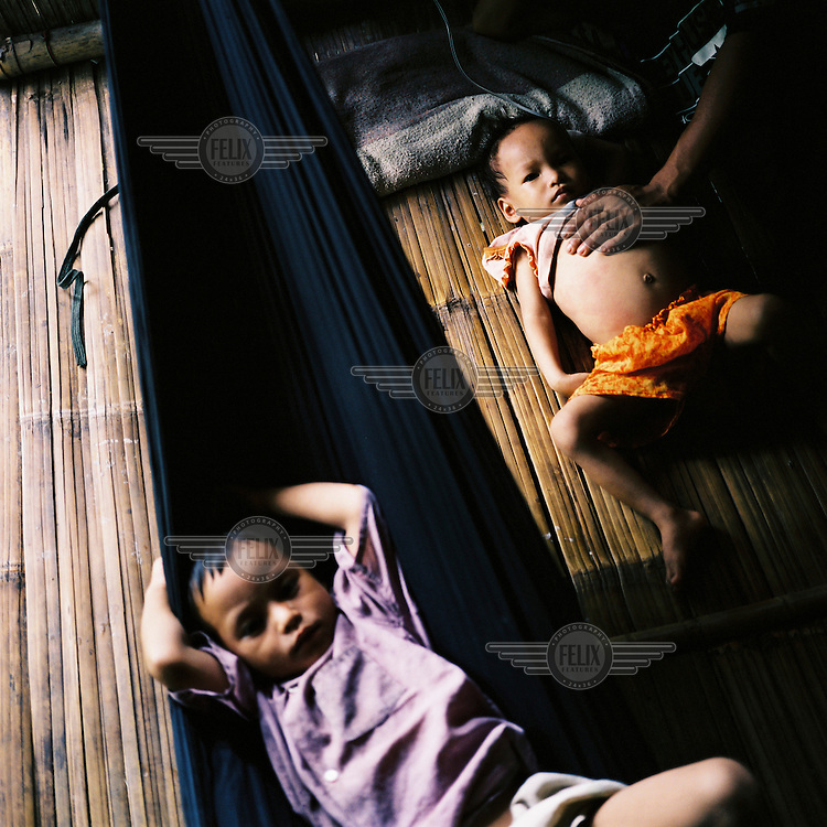 Sick Karen children in a clinic in an IDP (internally displaced person) camp in the Karen state.