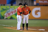 Kannapolis Intimidators manager Justin Jirschele (9) gives instructions to Mitch Roman (10) during the game against the Lakewood BlueClaws at Kannapolis Intimidators Stadium on April 8, 2017 in Kannapolis, North Carolina.  The BlueClaws defeated the Intimidators 8-4 in 10 innings.  (Brian Westerholt/Four Seam Images)