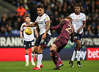 Bolton Wanderers' Josh Magennis competing with Swansea City's Jay Fulton<br /> <br /> Photographer Andrew Kearns/CameraSport<br /> <br /> The EFL Sky Bet Championship - Bolton Wanderers v Swansea City - Saturday 10th November 2018 - University of Bolton Stadium - Bolton<br /> <br /> World Copyright © 2018 CameraSport. All rights reserved. 43 Linden Ave. Countesthorpe. Leicester. England. LE8 5PG - Tel: +44 (0) 116 277 4147 - admin@camerasport.com - www.camerasport.com
