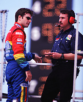 Jeff Gordon (left) and crew chief Robbie Loomis confer atop their hauler at Darlington, SC in March 2000. (Photo by Brian Cleary)