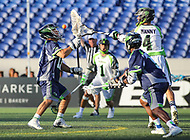 Annapolis, MD - July 7, 2018: Chesapeake Bayhawks Niko Amato (13) makes a save on New York Lizards Will Manny (4) during the game between New York Lizards and Chesapeake Bayhawks at Navy-Marine Corps Memorial Stadium in Annapolis, MD.   (Photo by Elliott Brown/Media Images International)