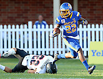 BROOKINGS, SD - SEPTEMBER 12:  Je Ryan Butler #22 from South Dakota State looks for room following a punt past Kyle Hannemann #22 from Southern Utah in the first half of their game Saturday night in Brookings. (Photo by Dave Eggen/Inertia)