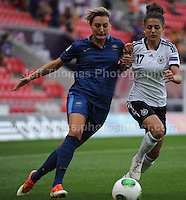 Claire Lavogez of France battles with Manjou Wilde of Germany  during the UEFA Womens U19 Semi-Final at Parc y Scarlets Wednesday 28th August 2013. All images are the copyright of Jeff Thomas Photography-www.jaypics.photoshelter.com-07837 386244-Any use of images must be authorised by the copyright owner.