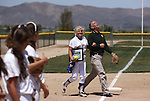Western Nevada College's Carlee Beck escorts Sheriff Kenny Furlong to the mound before a game against the College of Southern Nevada on Friday, May 2, 2014, in Carson City, Nev. Furlong, who threw out the first pitch, was reacting to the song &quot;I Shot the Sheriff&quot; on the PA.<br /> Photo by Cathleen Allison/Nevada Photo Source