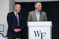 "Wake Forest baseball head coach Tom Walter (right) prepares to introduce guest speaker Jim Abbott at the Wake Forest Baseball ""First Pitch"" Dinner on February 9, 2017 in Winston-Salem, North Carolina.  (Brian Westerholt/Four Seam Images)"
