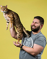 Bobby San Migeul of Soquel, Calif. holds his Bengal named Orestes at the 44th East of Eden Cat Fancier's in Monterey, Calif. on Feb. 22, 2020.