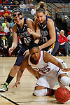 RAPID CITY, S.D. -- DECEMBER 7, 2013 -- Polly Harrington #33 of the University of South Dakota tries to control a loose ball while surrounded by Mackenzie Kenney #40 and Krista Showalter #20 of South Dakota Mines during their game Saturday at the Rushmore Plaza Civic Center Ice arena in Rapid City, S.D.  (Photo by Dick Carlson/Inertia)