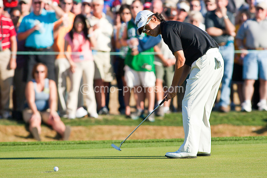 Feb 1, 2009; Scottsdale, AZ, USA; Kevin Na (KOR) watches as his birdie putt on the 18th hole, which would have qualified him for a playoff, misses left during the final round of the FBR Open at the TPC Scottsdale.  Mandatory Credit: Chris Morrison-US PRESSWIRE