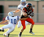 SIOUX FALLS, SD - SEPTEMBER 19: Logan Raabe #44 from Washington is hit by Luke Bates #10 from Rapid City Stevens in the first quarter of their game Friday night at Howard Wood Field.  (Photo by Dave Eggen/Inertia)