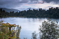 Sunset over Lake Mapourika near Franz Josef Glacier with mountains in background, Westland NP, West Coast, World Heritage, South Westland, New Zealand