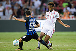 Kingsley Coman of Bayern (R) dribbles FC Internazionale Defender Yuto Nagatomo (L) during the International Champions Cup match between FC Bayern and FC Internazionale at National Stadium on July 27, 2017 in Singapore. Photo by Weixiang Lim / Power Sport Images