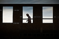 Construction workers install a series of walls on a house being built in Westerville, Ohio.