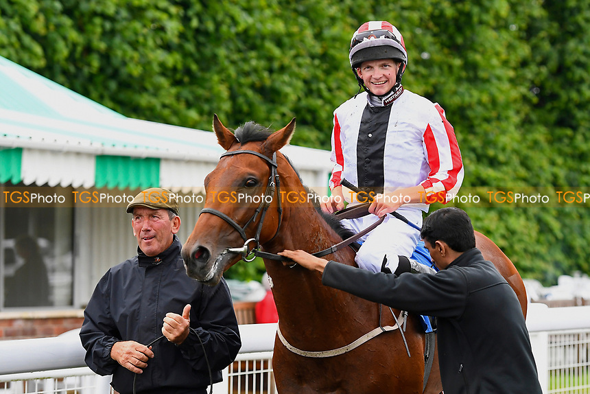 Winner of The New Forest Farm Machinery/John Deere Auction Stakes,  Veejay ridden by Rob Hornby and trained by Mick Channon is led into the winners enclosue during Whitsbury Manor Stud Bibury Cup Day Racing at Salisbury Racecourse on 28th June 2017