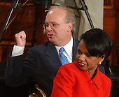 Senior Advisors Karl Rove and Condoleezza Rice have a discussion with other staff members prior to United States President George W. Bush's formal press conference from the East Room of the White House in Washington, DC on April 13, 2004.<br /> Credit: Ron Sachs / CNP