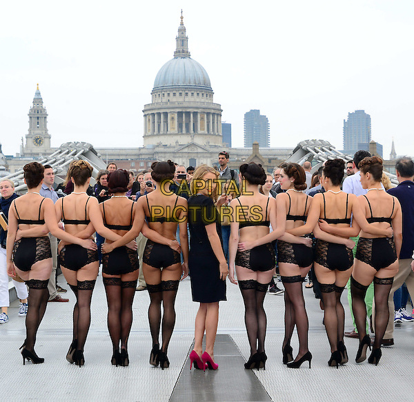 LONDON, ENGLAND - SEPTEMBER 11: The Only Way Is Essex star Lydia Bright poses on Millennium Bridge with a dance troupe during a photocall to promote The Art of Dressing mail order for designer Peter Hahn on September 11, 2014 in London, England.<br /> CAP/JOR<br /> &copy;Nils Jorgensen/Capital Pictures