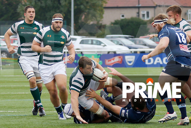Ealing's William Ryan is tackled during the Greene King IPA Championship match between Ealing Trailfinders and Bedford Blues at Castle Bar , West Ealing , England  on 29 October 2016. Photo by Carlton Myrie / PRiME Media
