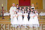 Pupils from Moyvane National School who receive their First Holy Communion at Moyvan Church on Saturday last. Front : Aobha Quinn, Brid Stack, Josephine Hughes, Holly Heffernan & Dion Pierce, Centre : Eamonn O'Connor, Kieran Swan, Michael Fogarty & Sean Stackpoole. Back: Fr. Lucid, Teacher Mary B Curtin, Thomas Walsh, Declan Sexton-McEnery, Conor Hogan & teacher Mairead McEnery.