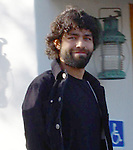 2-14-08   Thursday         Exclusive Adrian Grenier with his new black Beard leaving the Earth Cafe in HOllywood. He was reading the The Unusual Suspect book By:. Stephen Baldwin.AbilityFilms@yahoo.com.805-427-3519.www.AbilityFilms.com