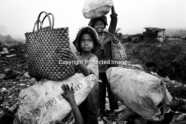 Unidentified children work at a garbage dump on March 5, 1998 at the Stung Meanchey garbage dump outside Phnom Penh, Cambodia. Hundreds of children aged 4-7 years old work in bad conditions making about $1 per day. Many families come from the Cambodian countryside looking for work and food. (Photo by: Per-Anders Pettersson)