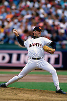 SAN FRANCISCO, CA - John Burkett of the San Francisco Giants pitches during a game at Candlestick Park in San Francisco, California in 1994. (Photo by Brad Mangin)