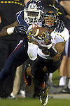 Maryland 25, Dexter McDougle, intercepts the ball intended fro UConn 8, Shakim Phillips, in the first half during the game, Saturday, Sept.  14, 2013,  at Rentchler in East Hartford.  (Jim Michaud / Journal Inquirer)