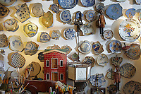 A collection of shards of early Dutch pottery from the 16th and 17th centuries is displayed on the wall of the study