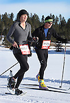 DEADWOOD, SD - JANUARY 23, 2016 -- Lisa Gustin #114 and Dan Bjerke #121 race toward the club house in their respective snowshoe and cross-country ski events during the 2016 Snow Jam Points Series at Tomahawk Country Club south of Deadwood, S.D. Saturday.  (Photo by Richard Carlson/dakotapress.org)