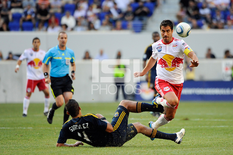 Juan Pablo Angel (9) of the New York Red Bulls is fouled by Omar Gonzalez (4) of the Los Angeles Galaxy. The Los Angeles Galaxy defeated the New York Red Bulls 1-0 during a Major League Soccer (MLS) match at Red Bull Arena in Harrison, NJ, on August 14, 2010.