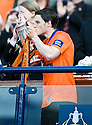 15/05/2010   Copyright  Pic : James Stewart.sct_js008_ross_county_v_dundee_utd  .:: TWO GOAL HERO CRAIG CONWAY GETS HIS HAND ON THE CUP   ::  .James Stewart Photography 19 Carronlea Drive, Falkirk. FK2 8DN      Vat Reg No. 607 6932 25.Telephone      : +44 (0)1324 570291 .Mobile              : +44 (0)7721 416997.E-mail  :  jim@jspa.co.uk.If you require further information then contact Jim Stewart on any of the numbers above.........